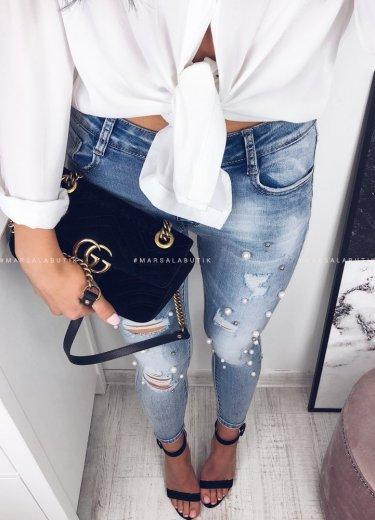 Jeansy przetarcia i perły