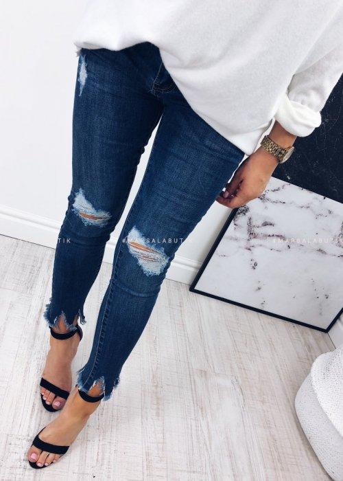 Jeansy WESTERN z dziurami i poszarpanymi nogawkami